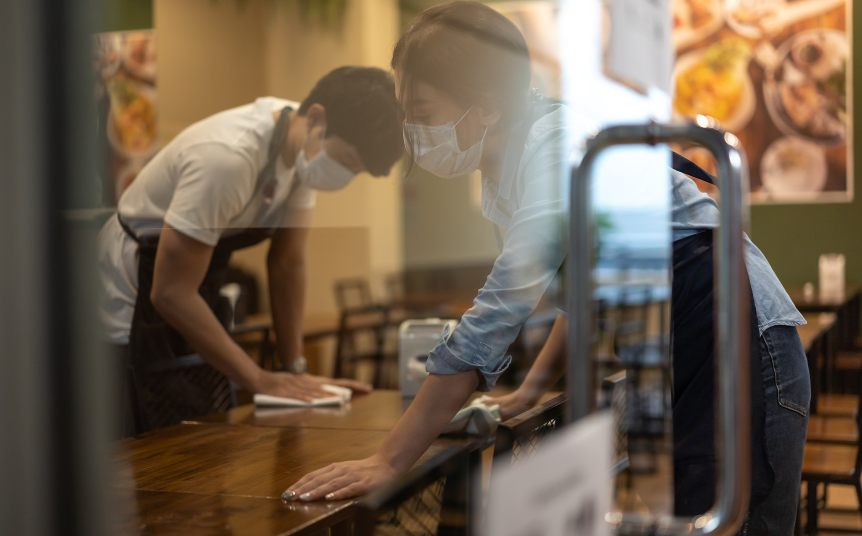 Wiping down table at coffee shop